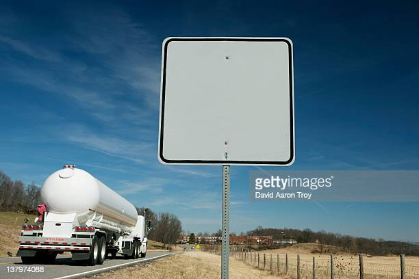 Tractor trailer and a blank road sign