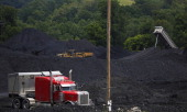 A tractor trailer navigates mounds of coal after delivering a truckload of coal to Arch Coal Terminals June 3 2014 in Cattletsburg Kentucky New...