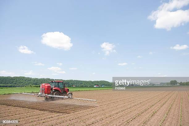 Tractor watering field