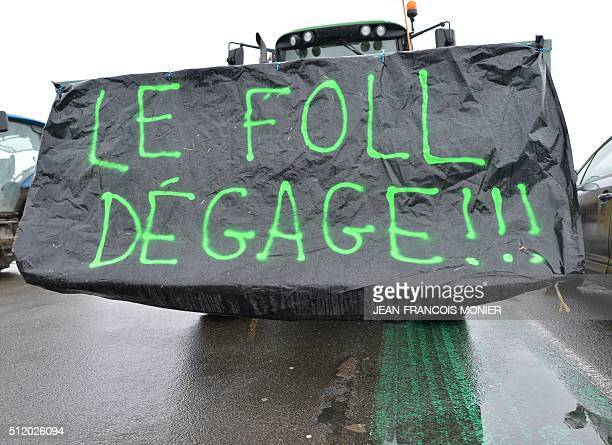 A tractor with a sign that reads 'Le Foll get out' takes part as a demonstration of French farmers as they protest against falling prices of dairy...