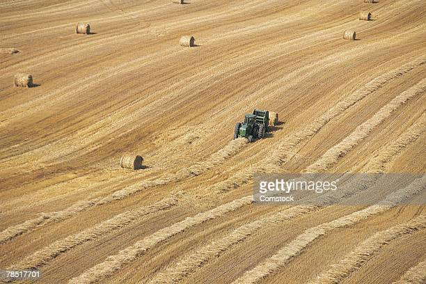 Tractor with bales of hay in field