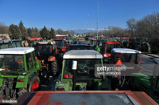 Tractors line the highway in front of the customs post at the border crossing of Promachonas between Greece and Bulgaria in northern Greece as...