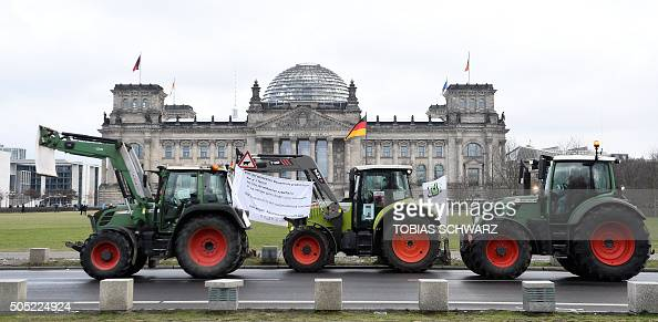 Tractors passes the Reichstag building seat of the German lower house of parliament Bundestag during the demonstration 'We Are Fed Up' against...