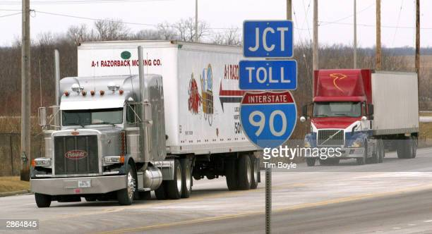 Tractortrailers move along an interstate frontage road January 13 2004 in Hampshire Illinois The US Department of Transportation has introduced new...