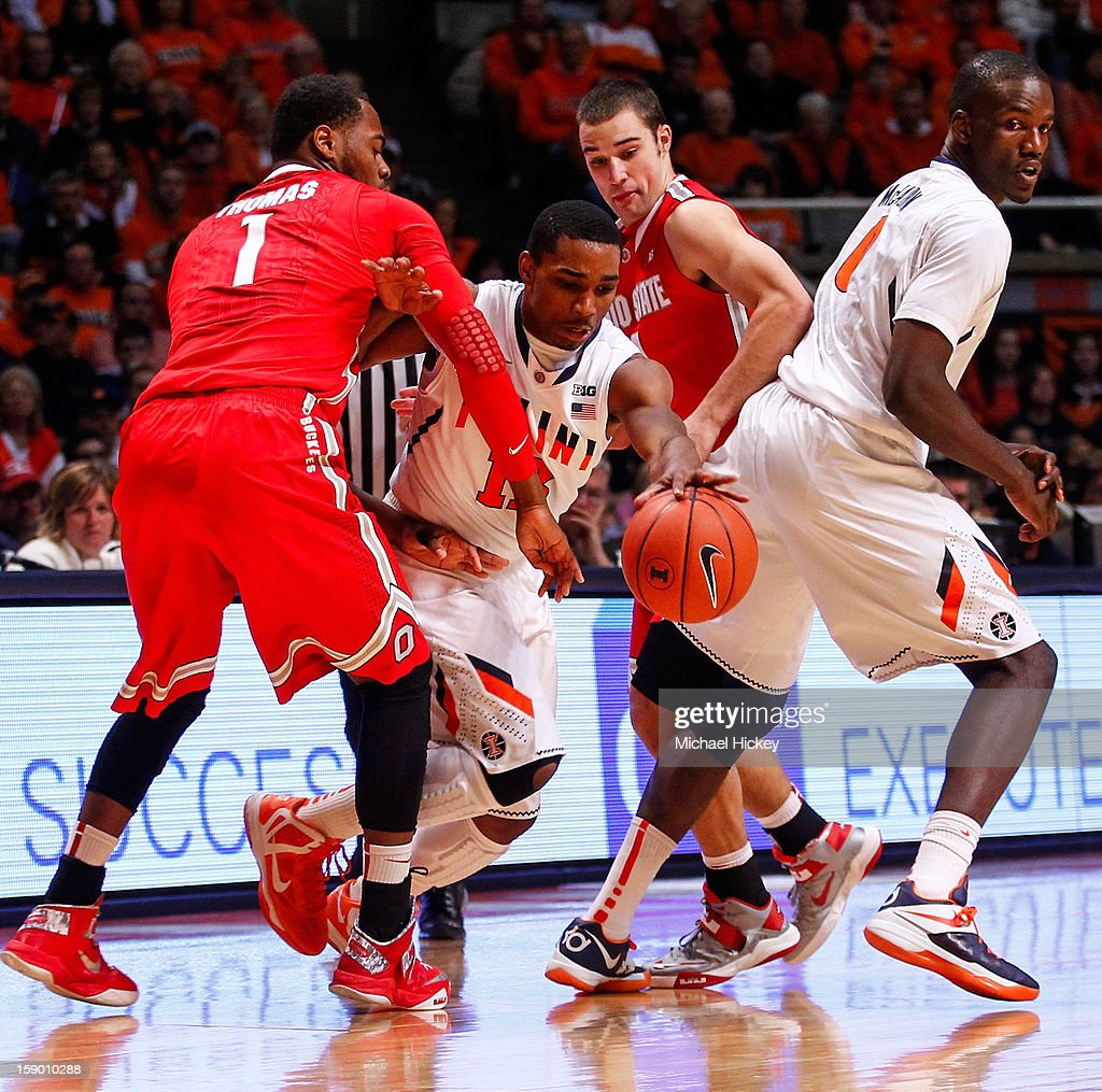 Tracy Abrams #13 of the Illinois Fighting Illini tries to dribble between the trap of Deshaun Thomas #1 of the Ohio State Buckeyes and <a gi-track='captionPersonalityLinkClicked' href=/galleries/search?phrase=Aaron+Craft&family=editorial&specificpeople=7348782 ng-click='$event.stopPropagation()'>Aaron Craft</a> #4 of the Ohio State Buckeyes at Assembly Hall on January 5, 2013 in Champaign, Illinois. Ilinois defeated Ohio State 74-55.