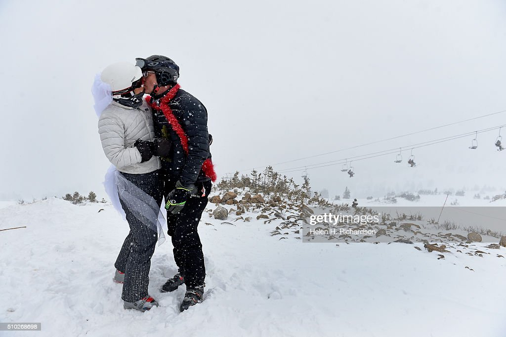 Tracy and Tim Heiman, of Boulder, kiss at around 12,000 feet at Loveland ski area before the 25th annual Mountaintop Matrimony Valentine's day wedding ceremony on February 14, 2016 at the Loveland Ski area near Georgetown, Colorado. The ceremony was held at Ptarmigan Roost cabin at the top of Ptarmigan lift. Approximately 100 couples got married or renewed their vows with minister Harry Heilmann, of the Universal Life Church, overseeing the ceremony.