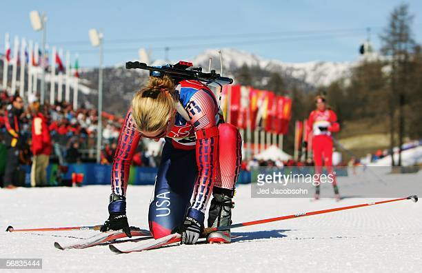 Tracy Barnes of the United States collapses at the finish line after competing in the Womens Biathlon 15km Individual Final on Day 3 of the 2006...