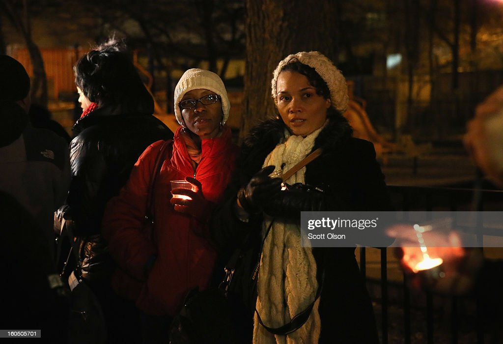 Tracy Croon (L) and Angela Marie join other community members for a candle light vigil at Harsh park to honor Hadiya Pendleton on February 1, 2013 in Chicago, Illinois. Pendleton, a fifteen-year-old high school honor student, was shot and killed while hanging out with friends on a rainy afternoon under a shelter in the park on January 29. A $40,000 reward has been raised to help find her killer. Pendleton was the 44th homicide recorded in Chicago for 2013.