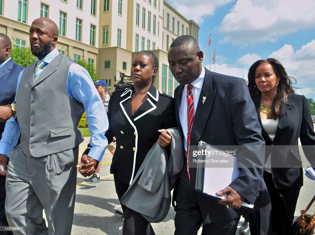 <a gi-track='captionPersonalityLinkClicked' href=/galleries/search?phrase=Tracy+Martin+-+Father+of+Trayvon+Martin&family=editorial&specificpeople=9075765 ng-click='$event.stopPropagation()'>Tracy Martin</a> and <a gi-track='captionPersonalityLinkClicked' href=/galleries/search?phrase=Sybrina+Fulton&family=editorial&specificpeople=9024062 ng-click='$event.stopPropagation()'>Sybrina Fulton</a>, parents of Trayvon Martin, their attorney <a gi-track='captionPersonalityLinkClicked' href=/galleries/search?phrase=Benjamin+Crump+-+Attorney&family=editorial&specificpeople=9042867 ng-click='$event.stopPropagation()'>Benjamin Crump</a> and attorney Natalie Jackson leave Seminole County courthouse without talking to reporters after the bond hearing for George Zimmerman on April 20, 2012 in Sanford, Florida. Trayvon Martin was shot by George Zimmerman, a member of a neighborhood watch in Sanford, Florida, who has been charged with second degree murder in the shooting. Bail was set at $150,000 for Zimmerman and he could be released from jail as early as April 21.