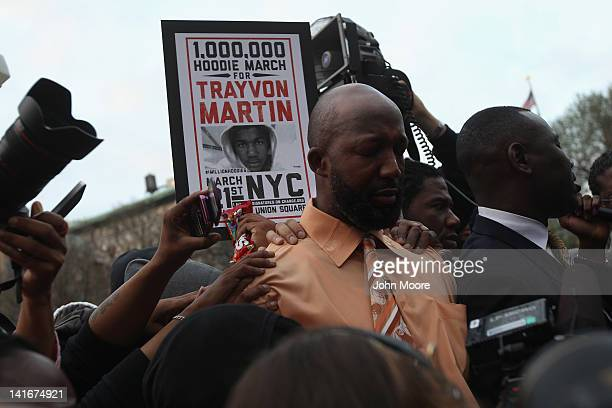 Tracy Martin father of slain teenager Trayvon Martin prays with fellow protesters at a Million Hoodies March on March 21 2012 in New York City The...
