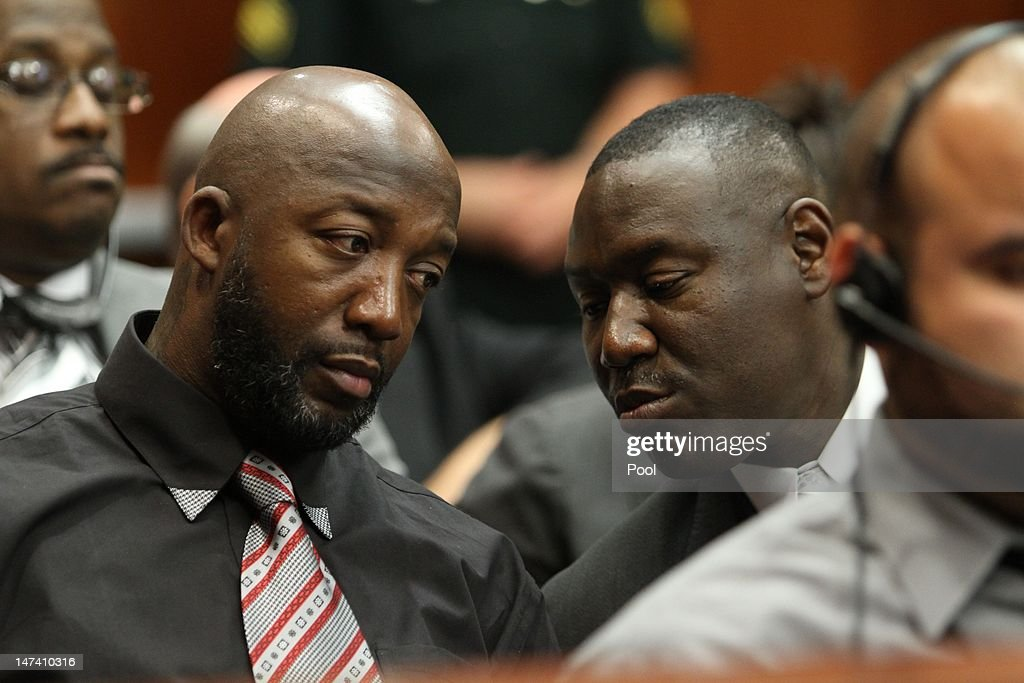 <a gi-track='captionPersonalityLinkClicked' href=/galleries/search?phrase=Tracy+Martin+-+Father+of+Trayvon+Martin&family=editorial&specificpeople=9075765 ng-click='$event.stopPropagation()'>Tracy Martin</a>, father of Trayvon Martin, confers with his attorney <a gi-track='captionPersonalityLinkClicked' href=/galleries/search?phrase=Benjamin+Crump+-+Attorney&family=editorial&specificpeople=9042867 ng-click='$event.stopPropagation()'>Benjamin Crump</a> during the bond hearing for George Zimmerman on June 29, 2012 in Sanford, Florida. Zimmerman is charged with second degree murder in the shooting death of Trayvon Martin.