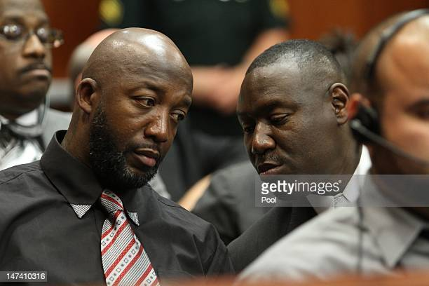 Tracy Martin father of Trayvon Martin confers with his attorney Benjamin Crump during the bond hearing for George Zimmerman on June 29 2012 in...