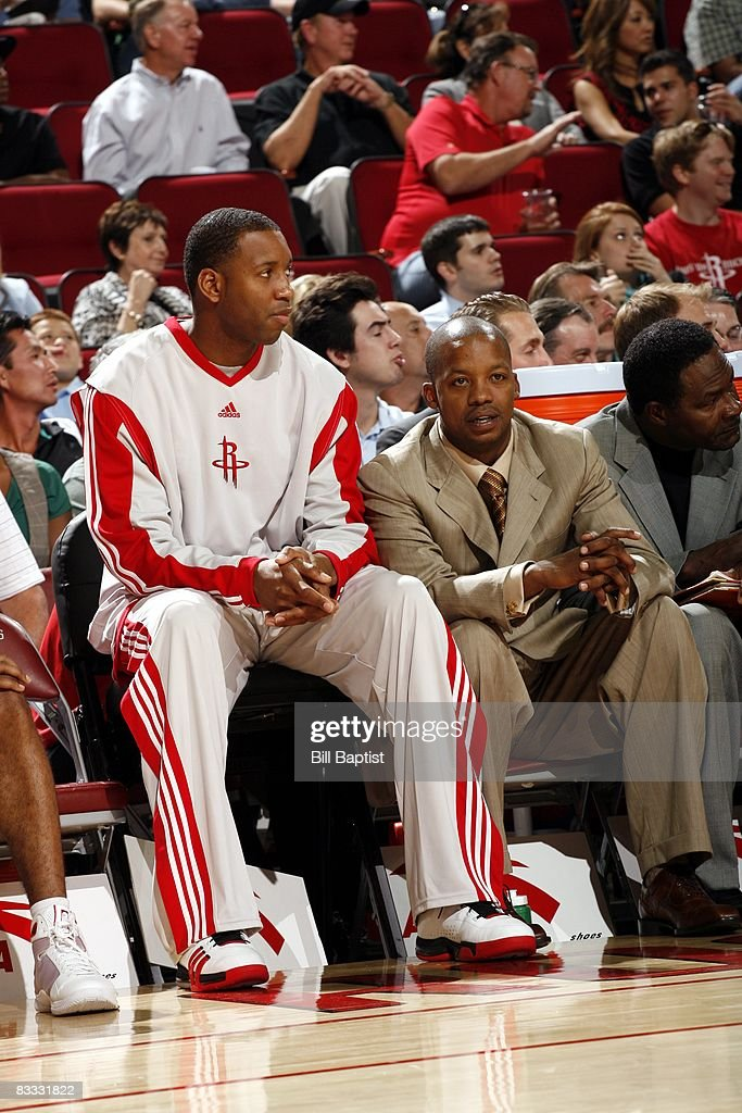 Tracy McGrady #1 and Steve Francis of the Houston Rockets watch the action from the sideline during the game against the San Antonio Spurs at the Toyota Center on October 9, 2008 in Houston, Texas. The Rockets won 85-78.