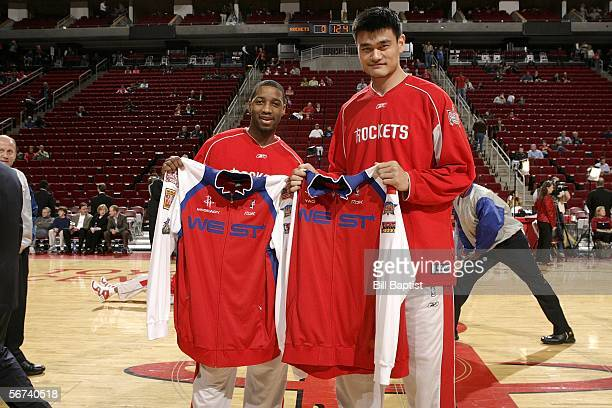 Tracy McGrady and Yao Ming of the Houston Rockets receive their AllStar jerseys prior to the game against the Seattle Supersonics on February 3 2006...