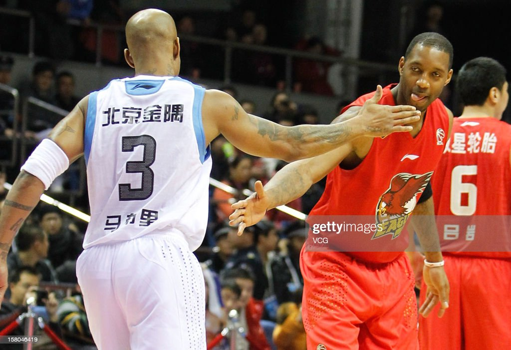 Tracy McGrady #9 of Qingdao Eagles and Stephon Marbury #3 of Beijing Ducks high five prior to the seventh round of the CBA 12/13 game at Shougang Basketball Centre on December 9, 2012 in Beijing, China.