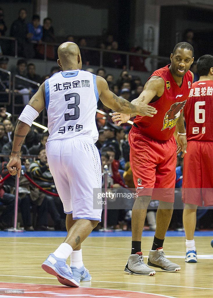 <a gi-track='captionPersonalityLinkClicked' href=/galleries/search?phrase=Tracy+McGrady&family=editorial&specificpeople=201486 ng-click='$event.stopPropagation()'>Tracy McGrady</a> #9 of Qingdao Eagles and <a gi-track='captionPersonalityLinkClicked' href=/galleries/search?phrase=Stephon+Marbury&family=editorial&specificpeople=201496 ng-click='$event.stopPropagation()'>Stephon Marbury</a> #3 of Beijing Ducks high five prior to the seventh round of the CBA 12/13 game at Shougang Basketball Centre on December 9, 2012 in Beijing, China.
