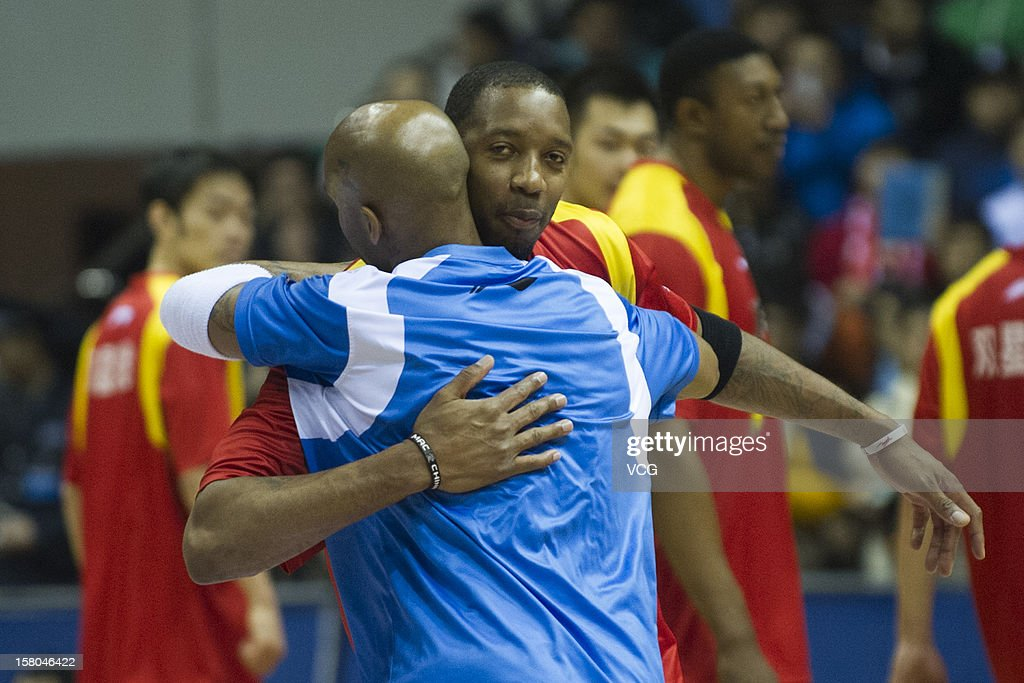<a gi-track='captionPersonalityLinkClicked' href=/galleries/search?phrase=Tracy+McGrady&family=editorial&specificpeople=201486 ng-click='$event.stopPropagation()'>Tracy McGrady</a> #9 of Qingdao Eagles and <a gi-track='captionPersonalityLinkClicked' href=/galleries/search?phrase=Stephon+Marbury&family=editorial&specificpeople=201496 ng-click='$event.stopPropagation()'>Stephon Marbury</a> #3 of Beijing Ducks embrace after the seventh round of the CBA 12/13 game at Shougang Basketball Centre on December 9, 2012 in Beijing, China.