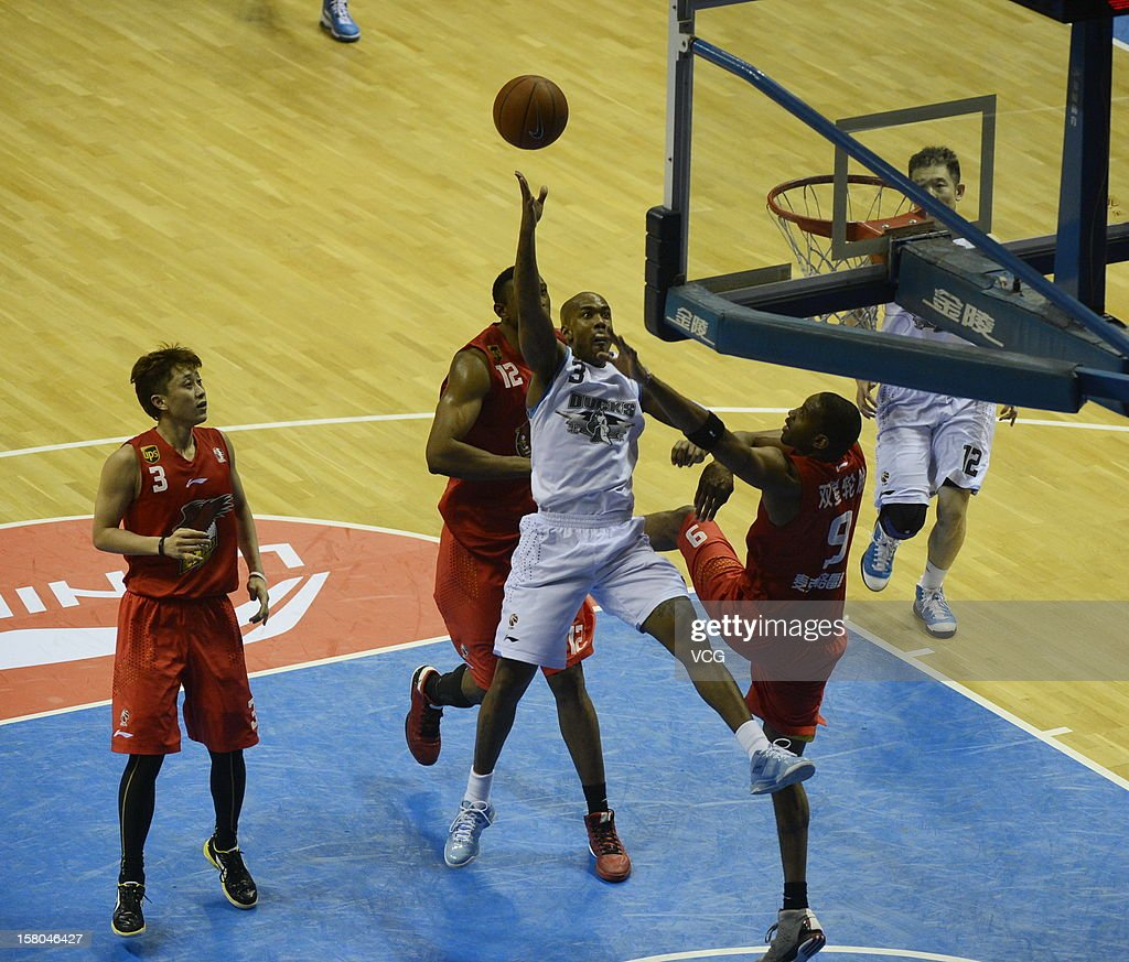 <a gi-track='captionPersonalityLinkClicked' href=/galleries/search?phrase=Tracy+McGrady&family=editorial&specificpeople=201486 ng-click='$event.stopPropagation()'>Tracy McGrady</a> #9 of Qingdao Eagles defends against <a gi-track='captionPersonalityLinkClicked' href=/galleries/search?phrase=Stephon+Marbury&family=editorial&specificpeople=201496 ng-click='$event.stopPropagation()'>Stephon Marbury</a> #3 of Beijing Ducks during the seventh round of the CBA 12/13 game at Shougang Basketball Centre on December 9, 2012 in Beijing, China.