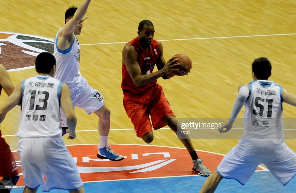 <a gi-track='captionPersonalityLinkClicked' href=/galleries/search?phrase=Tracy+McGrady&family=editorial&specificpeople=201486 ng-click='$event.stopPropagation()'>Tracy McGrady</a> #9 of Qingdao Eagles drives the ball during the seventh round of the CBA 12/13 game against Beijing Ducks at Shougang Basketball Centre on December 9, 2012 in Beijing, China.
