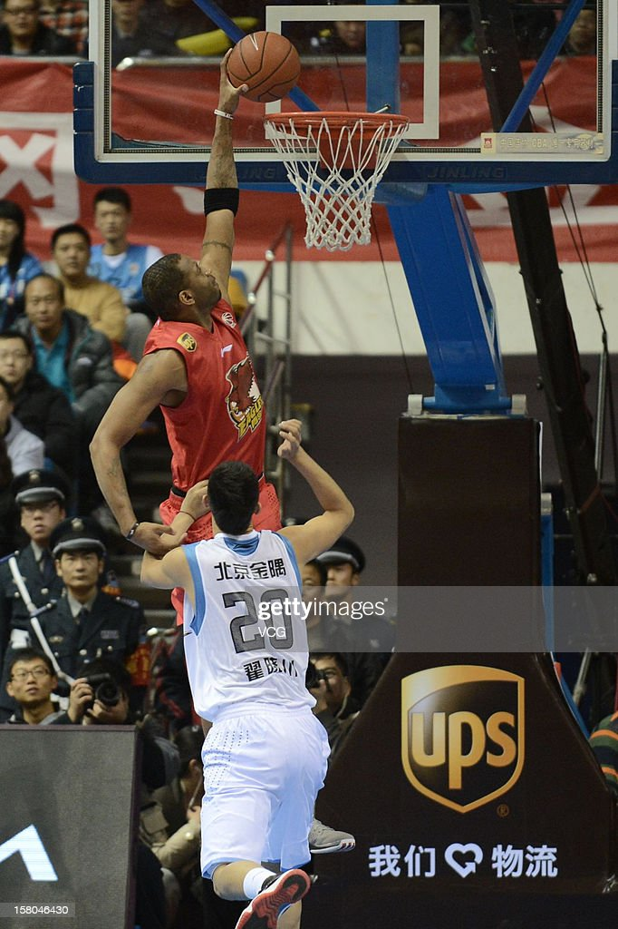 <a gi-track='captionPersonalityLinkClicked' href=/galleries/search?phrase=Tracy+McGrady&family=editorial&specificpeople=201486 ng-click='$event.stopPropagation()'>Tracy McGrady</a> #9 of Qingdao Eagles dunks during the seventh round of the CBA 12/13 game against Beijing Ducks at Shougang Basketball Centre on December 9, 2012 in Beijing, China.