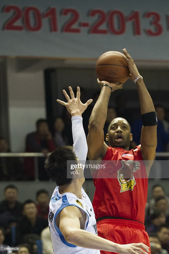 <a gi-track='captionPersonalityLinkClicked' href=/galleries/search?phrase=Tracy+McGrady&family=editorial&specificpeople=201486 ng-click='$event.stopPropagation()'>Tracy McGrady</a> #9 of Qingdao Eagles shoots the ball during the seventh round of the CBA 12/13 game against Beijing Ducks at Shougang Basketball Centre on December 9, 2012 in Beijing, China.