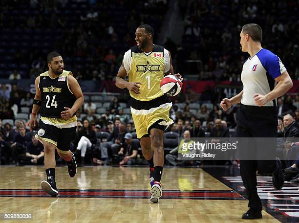 Tracy McGrady of Team Canada dribbles the ball as O'Shea Jackson Jr #24 of Team USA chases during the NBA AllStar Celebrity Game at the Ricoh...