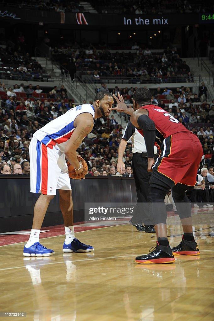 <a gi-track='captionPersonalityLinkClicked' href=/galleries/search?phrase=Tracy+McGrady&family=editorial&specificpeople=201486 ng-click='$event.stopPropagation()'>Tracy McGrady</a> #1 of the Detroit Pistons looks to drive against <a gi-track='captionPersonalityLinkClicked' href=/galleries/search?phrase=Dwyane+Wade&family=editorial&specificpeople=201481 ng-click='$event.stopPropagation()'>Dwyane Wade</a> #3 of the Miami Heat on March 23, 2011 at The Palace of Auburn Hills in Auburn Hills, Michigan.