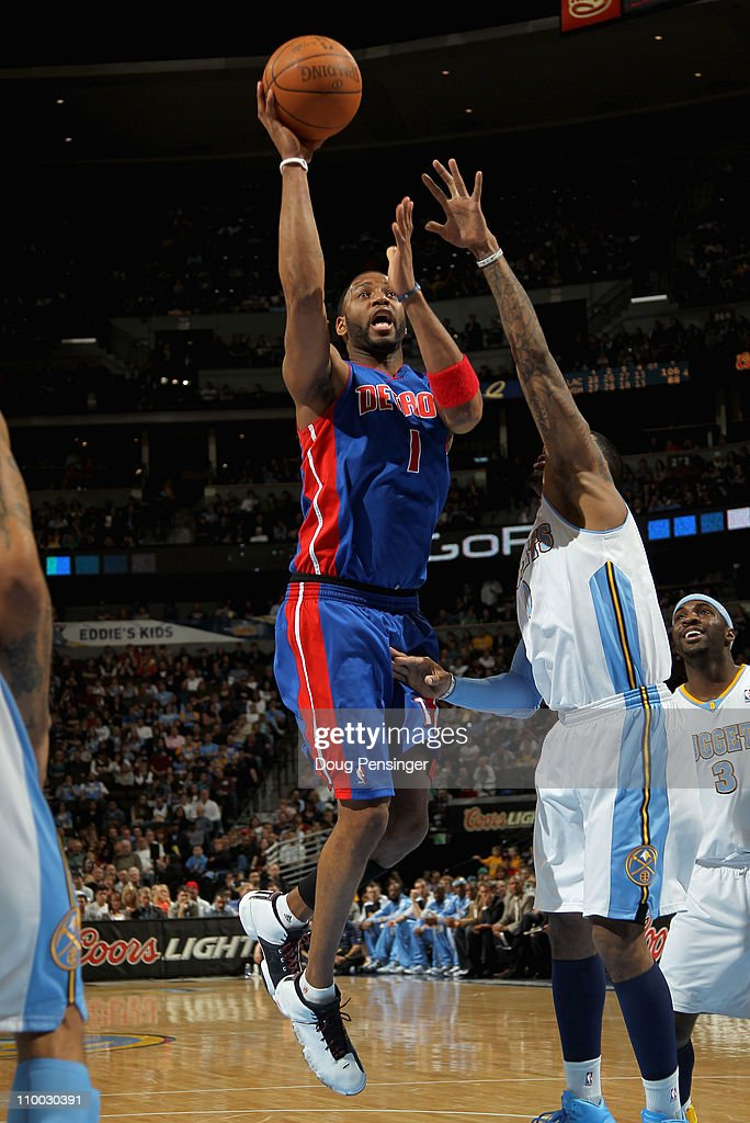 Tracy McGrady #1 of the Detroit Pistons takes a shot over Gary Forbes #0 of the Denver Nuggets at the Pepsi Center on March 12, 2011 in Denver, Colorado.