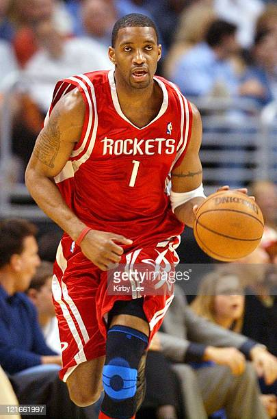 Tracy McGrady of the Houston Rockets brings the ball up the court during the NBA game between the Los Angeles Lakers and the Houston Rockets at the...