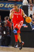 Tracy McGrady of the Houston Rockets dribbles upcourt during the game against the Phoenix Suns on April 9 2005 at America West Arena in Phoenix...