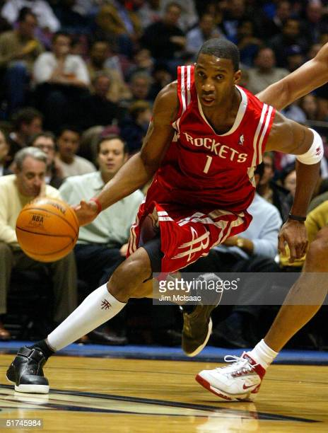 Tracy McGrady of the Houston Rockets drives down the court against the New Jersey Nets on November 15 2004 at the Continental Airlines Arena in East...