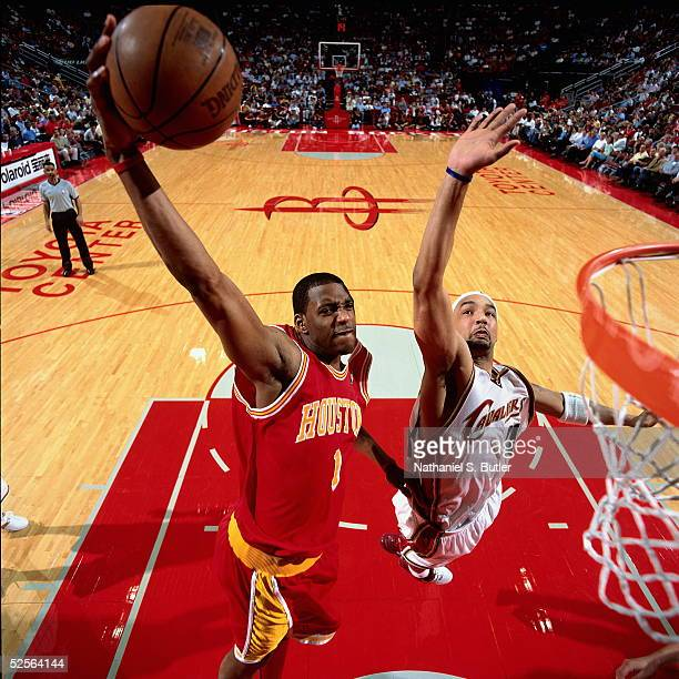Tracy McGrady of the Houston Rockets drives to the basket for the slam dunk past Drew Gooden of the Cleveland Cavaliers during an NBA game on March...