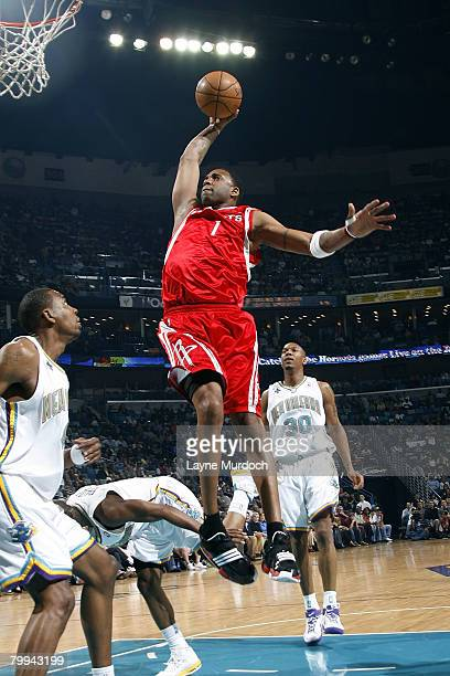 Tracy McGrady of the Houston Rockets dunks on Rasual Butler of the New Orleans Hornets at the New Orleans Arena February 22 2008 in New Orleans...