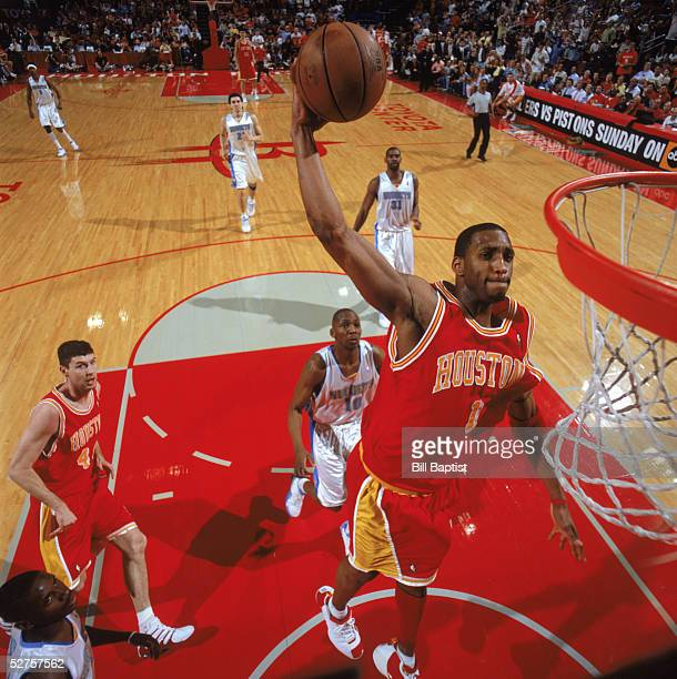 Tracy McGrady of the Houston Rockets goes for a dunk during the game against the Denver Nuggets at Toyota Center on April 16 2005 in Houston Texas...