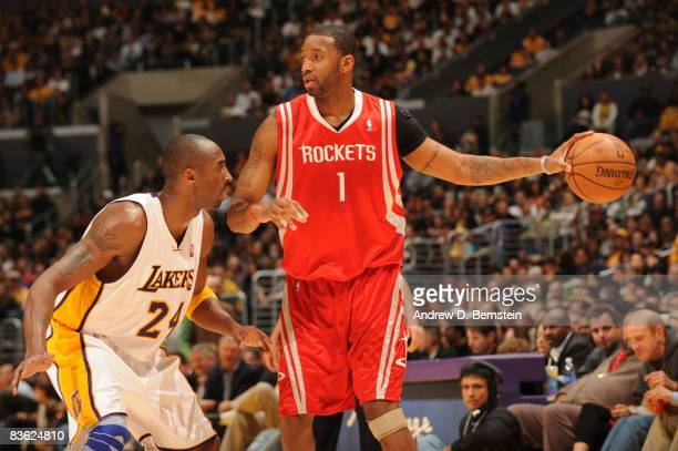 Tracy McGrady of the Houston Rockets holds the ball against Kobe Bryant of the Los Angeles Lakers at Staples Center on November 9 2008 in Los Angeles...