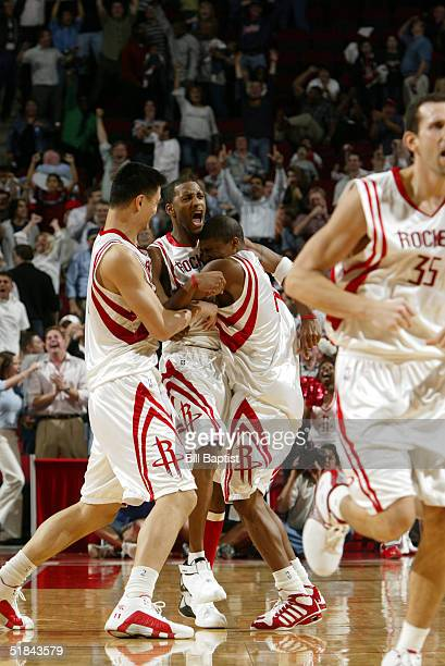 Tracy McGrady of the Houston Rockets is mobbed by teammates Reece Gaines and Yao Ming following McGrady's gamewinning 3point shot against the San...
