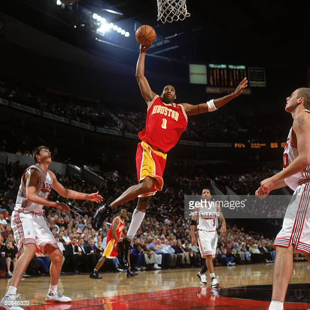 Tracy McGrady of the Houston Rockets makes a layup against the Portland Trail Blazers at Rose Garden on March 30 2005 in Portland Oregon Rockets won...