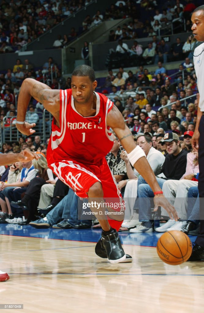 Tracy McGrady #1 of the Houston Rockets moves the ball during the game against the Los Angeles Clippers at Staples Center on November 20, 2004 in Los Angeles, California. The Rockets won in overtime 91-86.