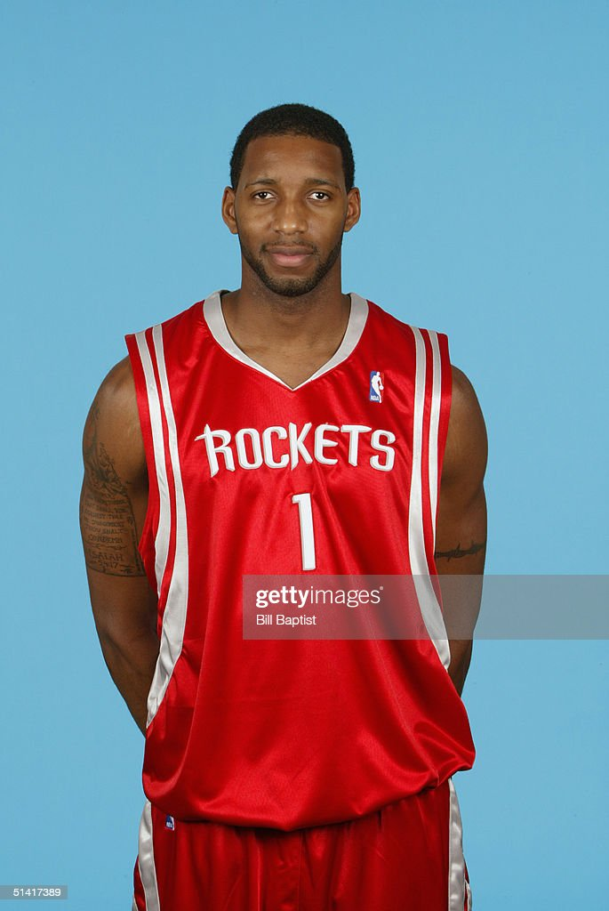 <a gi-track='captionPersonalityLinkClicked' href=/galleries/search?phrase=Tracy+McGrady&family=editorial&specificpeople=201486 ng-click='$event.stopPropagation()'>Tracy McGrady</a> #1 of the Houston Rockets poses for a portrait during NBA Media Day on October 1, 2004 in Houston, Texas.