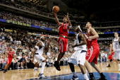 Tracy McGrady of the Houston Rockets shoots against the Dallas Mavericks in Game seven of the Western Conference Quarterfinals during the 2005 NBA...
