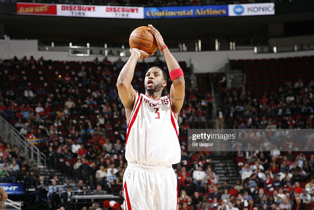 <a gi-track='captionPersonalityLinkClicked' href=/galleries/search?phrase=Tracy+McGrady&family=editorial&specificpeople=201486 ng-click='$event.stopPropagation()'>Tracy McGrady</a> #3 of the Houston Rockets shoots the against the Detroit Pistons on December 15, 2009 at the Toyota Center in Houston, Texas.