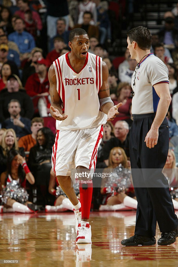 Tracy McGrady of the Houston Rockets talks to referee Scott Foster during the game against the San Antonio Spurs at Toyota Center on January 15 2005...