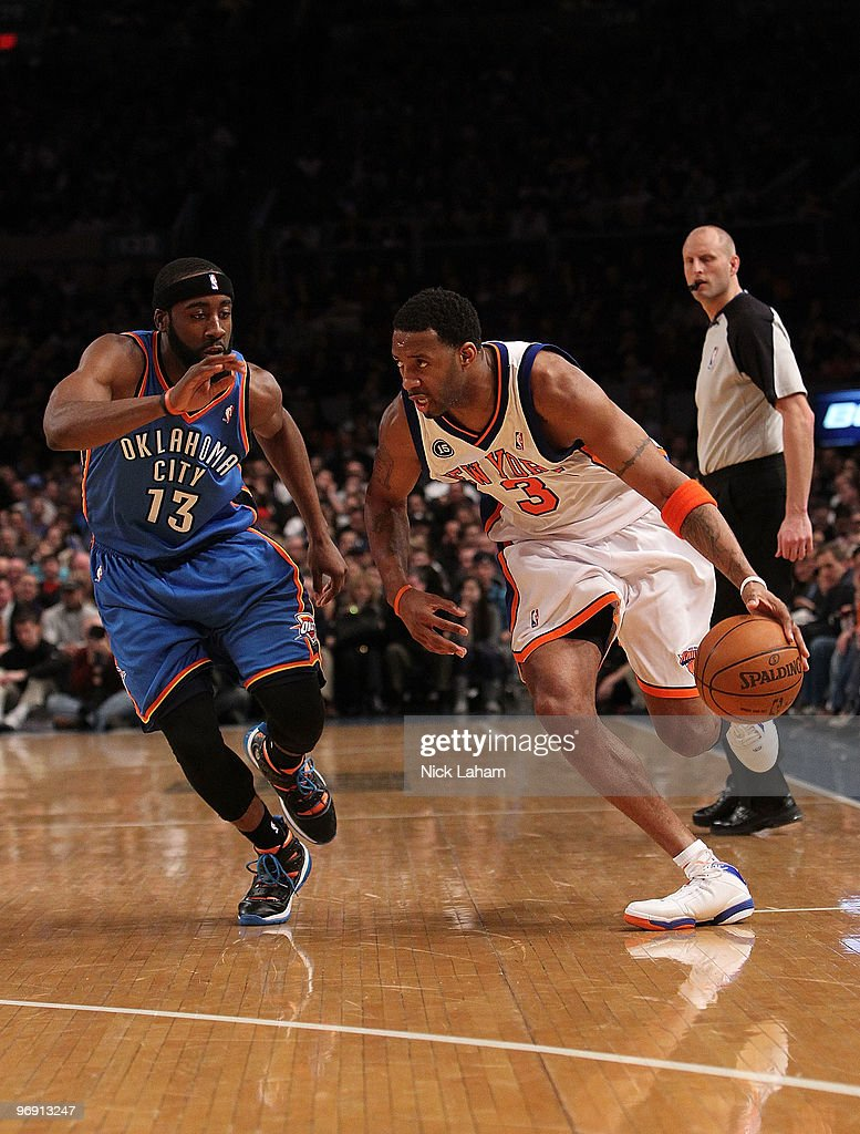Tracy McGrady #3 of the New York Knicks drives the ball against James Harden #13 of the Oklahoma City Thunder at Madison Square Garden on February 20, 2010 in New York, New York.