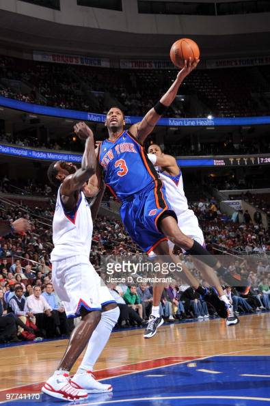 Tracy McGrady of the New York Knicks shoots against Samuel Dalembert of the Philadelphia 76ers during the game on March 15 2010 at the Wachovia...