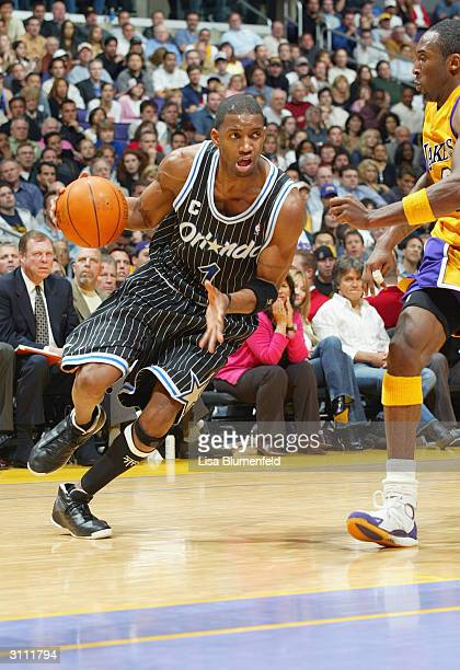 Tracy McGrady of the Orlando Magic drives past Kobe Bryant of the Los Angeles Lakers during the game at Staples Center on March 15 2004 in Los...