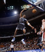 Tracy McGrady of the Orlando Magic follows through on his slam dunk against the Cleveland Cavaliers during the game on December 25 2003 at TD...