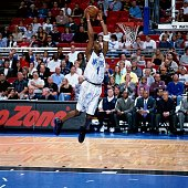 Tracy McGrady of the Orlando Magic goes for the slam dunk during an NBA game circa 2001 in Orlando Florida NOTE TO USER User expressly acknowledges...