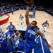 Tracy McGrady of the Orlando Magic goes up for a dunk during the game against the Minnesota Timberwolves at Target Center on February 3 2004 in...