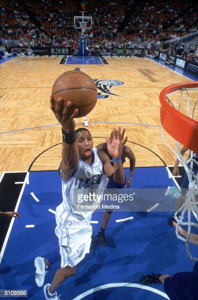 Tracy McGrady of the Orlando Magic lays the ball up during the game against the Washington Wizards at the TD Waterhouse Centre on March 10 2004 in...