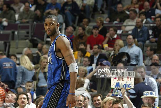 Tracy McGrady of the Orlando Magic looks back as he walks to the bench during play against the Detroit Pistons in Game two of the Eastern Conference...